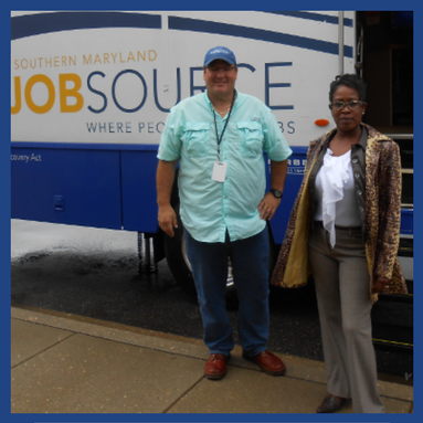 JobSource Mobile Career Center van with man and woman standing in front of it