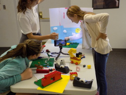3 teen girls setting up a stop motion scene