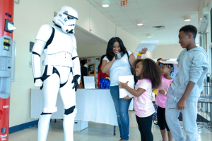 young girl interacting with a person dressed as a stormtrooper
