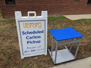 table with scheduled carless pickup sign