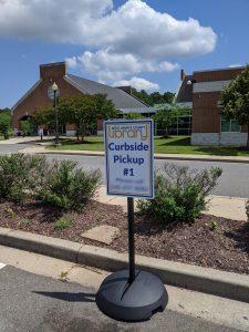 Driveup sign in a parking spot