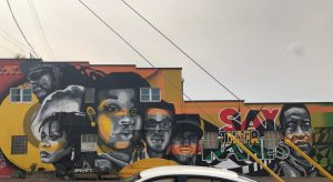 Outdoor mural of George Floyd, Breona Taylor, and others with the word Say Their Names