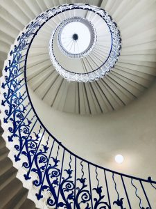 view from below of a spiral staircase with blue design