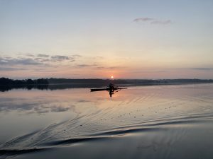 Single kayaker on the water at sunset
