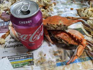 Cooked blue crabs and a cherry coke