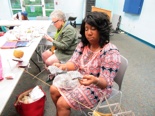 photo of 2 women knitting and crocheting